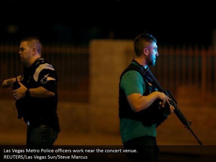 Las Vegas Metro Police officers work near the concert venue.  REUTERS/Las Vegas Sun/Steve Marcus