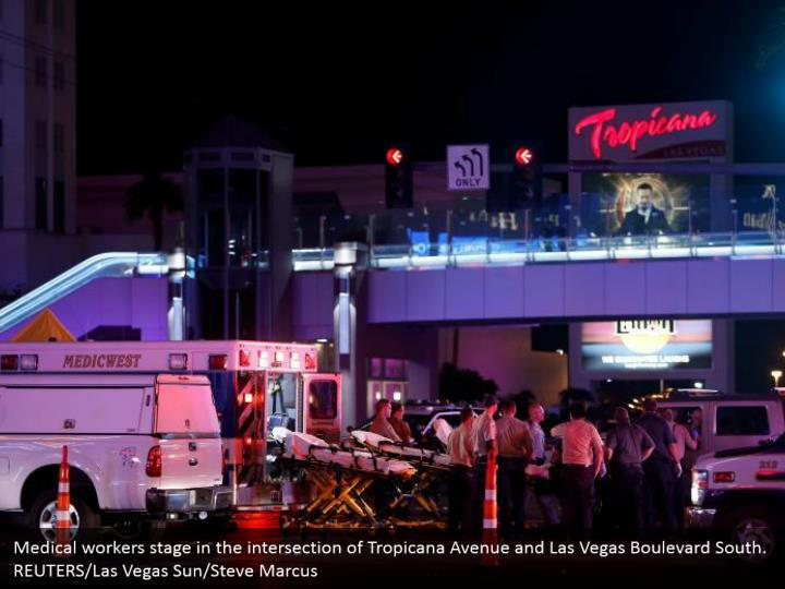 Medical workers stage in the intersection of Tropicana Avenue and Las Vegas Boulevard South.  REUTERS/Las Vegas Sun/Steve Marcus