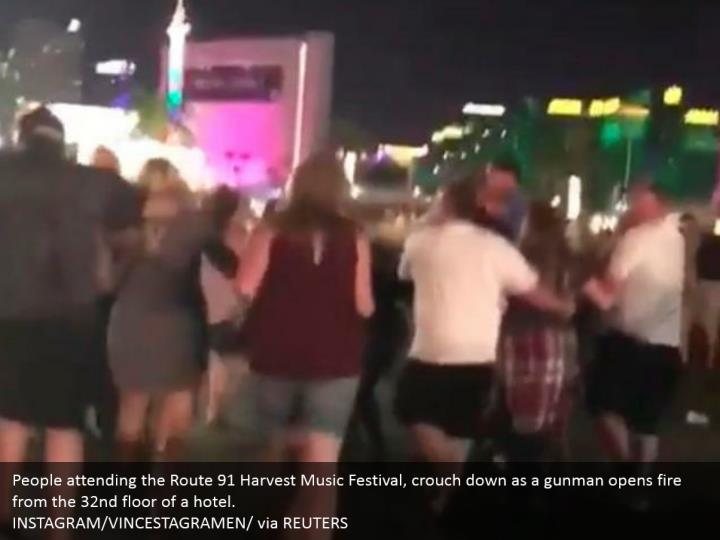 People attending the Route 91 Harvest Music Festival, crouch down as a gunman opens fire from the 32nd floor of a hotel.  INSTAGRAM/VINCESTAGRAMEN/ via REUTERS