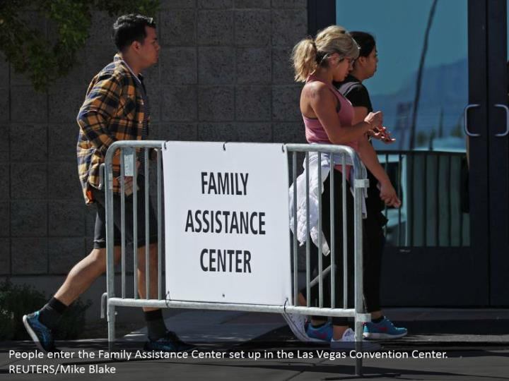 People enter the Family Assistance Center set up in the Las Vegas Convention Center. REUTERS/Mike Blake