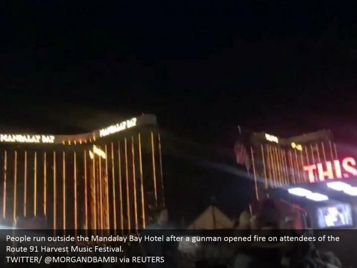 People run outside the Mandalay Bay Hotel after a gunman opened fire on attendees of the Route 91 Harvest Music Festival.  TWITTER/ @MORGANDBAMBI via REUTERS