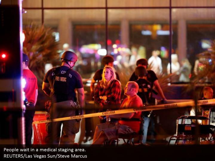 People wait in a medical staging area.  REUTERS/Las Vegas Sun/Steve Marcus
