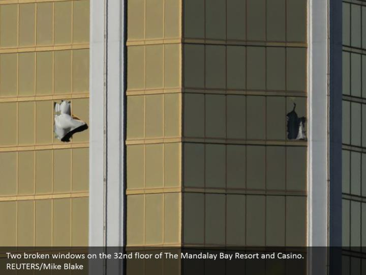 Two broken windows on the 32nd floor of The Mandalay Bay Resort and Casino.  REUTERS/Mike Blake