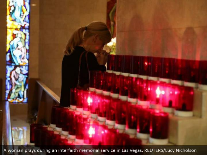 A woman prays during an interfaith memorial service in Las Vegas. REUTERS/Lucy Nicholson
