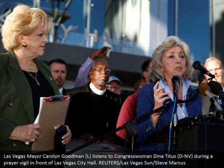 Las Vegas Mayor Carolyn Goodman (L) listens to Congresswoman Dina Titus (D-NV) during a prayer vigil in front of Las Vegas City Hall. REUTERS/Las Vegas Sun/Steve Marcus