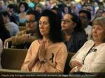 people pray during an interfaith memorial service