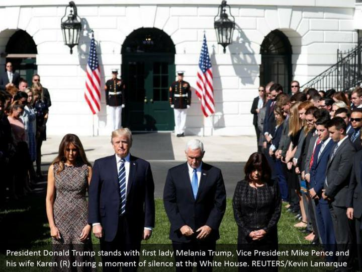 President Donald Trump stands with first lady Melania Trump, Vice President Mike Pence and his wife Karen (R) during a moment of silence at the White House. REUTERS/Kevin Lamarque