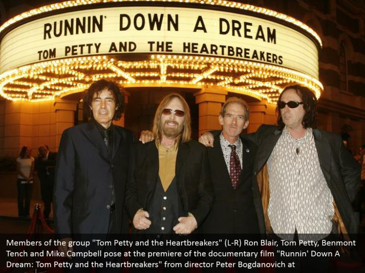 """Members of the group """"Tom Petty and the Heartbreakers"""" (L-R) Ron Blair, Tom Petty, Benmont Tench and Mike Campbell pose at the premiere of the documentary film """"Runnin' Down A Dream: Tom Petty and the Heartbreakers"""" from director Peter Bogdanovich at"""