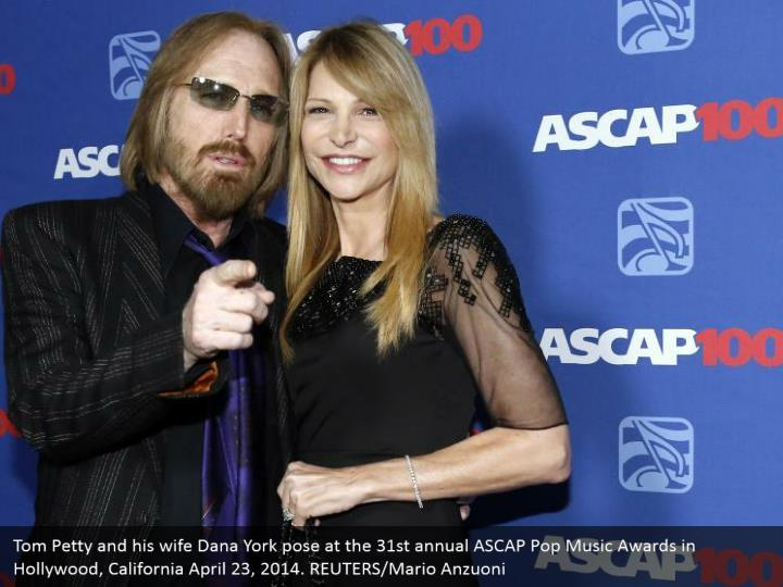 Tom Petty and his wife Dana York pose at the 31st annual ASCAP Pop Music Awards in Hollywood, California April 23, 2014. REUTERS/Mario Anzuoni