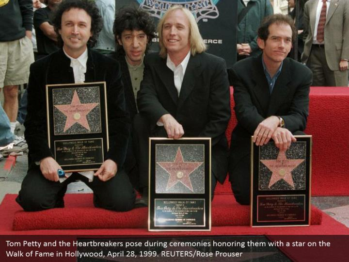 Tom Petty and the Heartbreakers pose during ceremonies honoring them with a star on the Walk of Fame in Hollywood, April 28, 1999. REUTERS/Rose Prouser