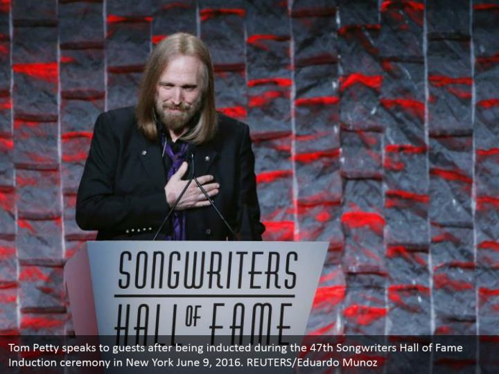 Tom Petty speaks to guests after being inducted during the 47th Songwriters Hall of Fame Induction ceremony in New York June 9, 2016. REUTERS/Eduardo Munoz