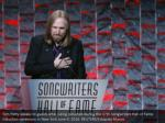 tom petty speaks to guests after being inducted