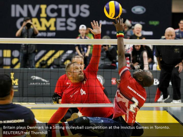 Britain plays Denmark in a Sitting Volleyball competition at the Invictus Games in Toronto. REUTERS/Fred Thornhill