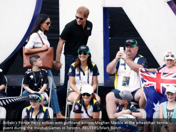 Britain's Prince Harry arrives with girlfriend actress Meghan Markle at the wheelchair tennis event during the Invictus Games in Toronto. REUTERS/Mark Blinch