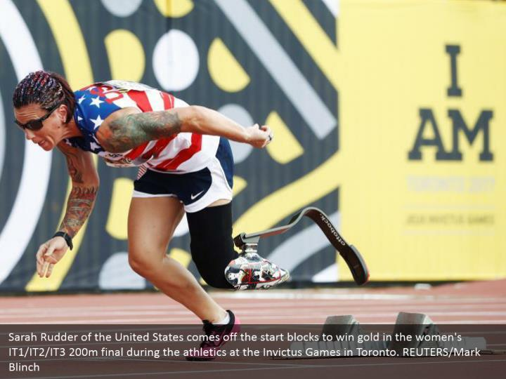Sarah Rudder of the United States comes off the start blocks to win gold in the women's IT1/IT2/IT3 200m final during the athletics at the Invictus Games in Toronto. REUTERS/Mark Blinch