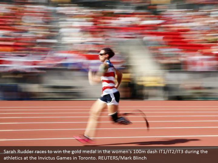 Sarah Rudder races to win the gold medal in the women's 100m dash IT1/IT2/IT3 during the athletics at the Invictus Games in Toronto. REUTERS/Mark Blinch