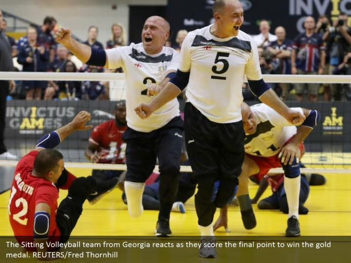 The Sitting Volleyball team from Georgia reacts as they score the final point to win the gold medal. REUTERS/Fred Thornhill
