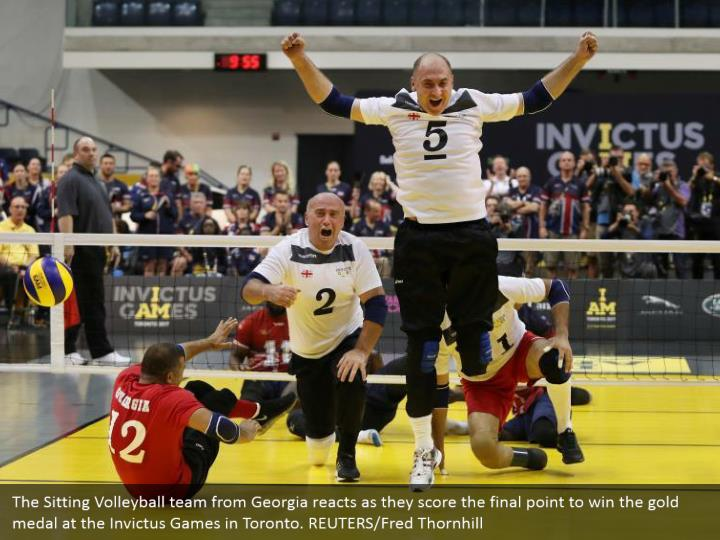 The Sitting Volleyball team from Georgia reacts as they score the final point to win the gold medal at the Invictus Games in Toronto. REUTERS/Fred Thornhill
