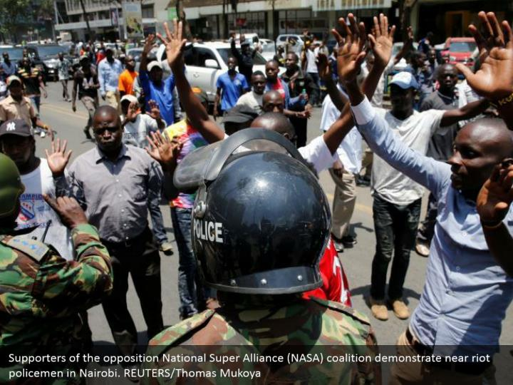 Supporters of the opposition National Super Alliance (NASA) coalition demonstrate near riot policemen in Nairobi. REUTERS/Thomas Mukoya