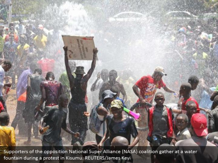 Supporters of the opposition National Super Alliance (NASA) coalition gather at a water fountain during a protest in Kisumu. REUTERS/James Keyi