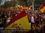 people shout slogans during spain s national