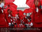 ushers manage umbrellas used by delegates