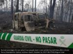 burned wreckage of a van where two people died