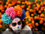 a woman dressed up as catrina a mexican character