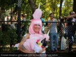 a woman dressed as cotton candy holds