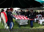 an honor guard folds and american flag which