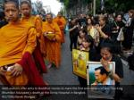 well wishers offer alms to buddhist monks to mark