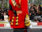 a police officer and mourners react as thailand