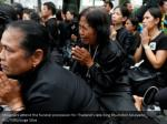 mourners attend the funeral procession
