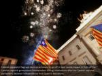 catalan separatist flags are held up as fireworks
