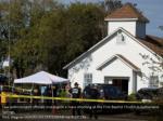 law enforcement officials investigate a mass 1