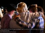 local residents embrace during a candlelight