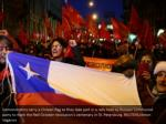demonstrators carry a chilean flag as they take
