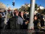 a palestinian man scuffles with an israeli border