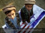 children stand on u s and israeli flags during