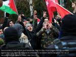 demonstrators hold turkish and palestinian flags