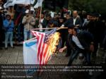 palestinians burn an israeli and a u s flag