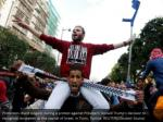 protesters chant slogans during a protest against