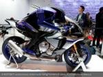 a motobot autonomous motorcycle riding humanoid