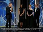 alexander skarsgaard kisses his award for best