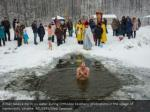 a man takes a dip in icy water during orthodox 1