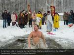 a man takes a dip in icy water during orthodox