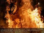a man rides a horse through flames during 2