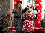 minnie mouse poses on her star with model heidi