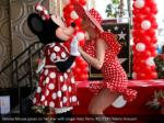 minnie mouse poses on her star with singer katy