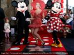 singer katy perry poses with mickey mouse